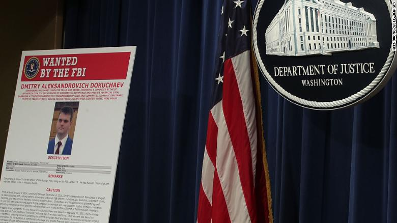 A wanted poster for FSB officer Dmitry Aleksandrovich Dokuchaev is displayed at the Justice Department on March 15, 2017.