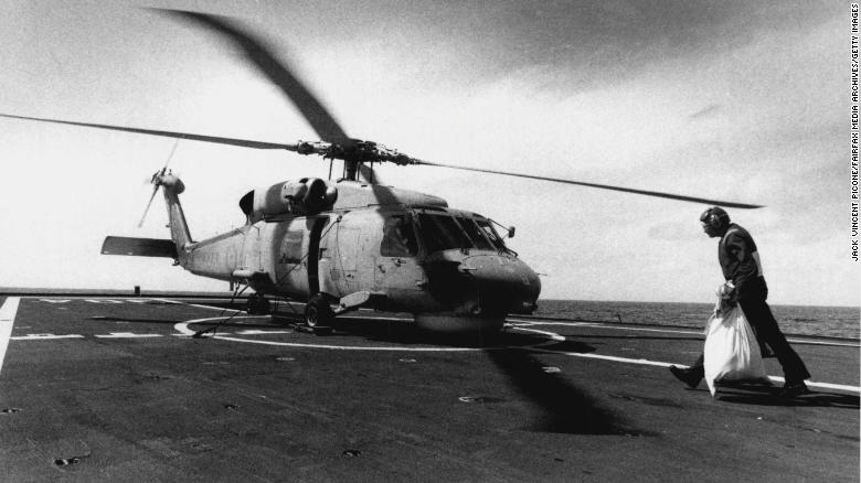 A chopper picks up mail bag to be taken to Diego Garcia in September, 1990.