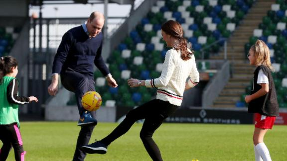 BELFAST, NORTHERN IRELAND - FEBRUARY 27:  Prince William Duke of Cambridge and Catherine, Duchess of Cambridge, play football during a visit the National Stadium in Belfast, home of the Irish Football Association on February 27, 2019 in Belfast, Northern Ireland. Prince William last visited Belfast in October 2017 without his wife, Catherine, Duchess of Cambridge, who was then pregnant with the couple's third child. This time the couple concentrate on the young people of Northern Ireland. Their engagements include a visit to Windsor Park Stadium, home of the Irish Football Association, activities at the Roscor Youth Village in Fermanagh, a party  at the Belfast Empire Hall, Cinemagic -a charity that uses film, television and digital technologies to inspire young people and finally dropping in on a SureStart early years programme. (Photo by Kelvin Boyes -  Pool/Getty Images)