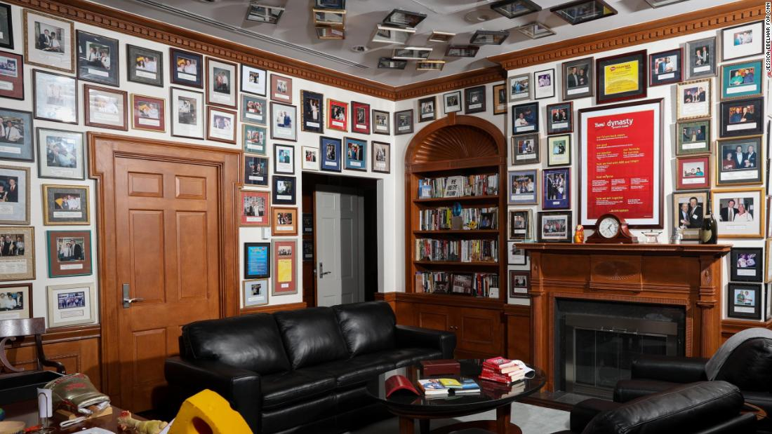 Novak's office walls and ceiling are lined with photos of him with former employees and their recognition awards.