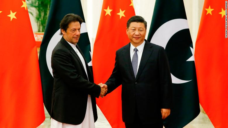 China's President Xi Jinping shakes hands with Pakistan's Prime  Minister Imran Khan on November 2.