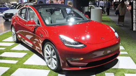 Tesla will raise prices after backtracking on store closures