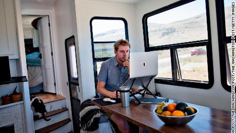Kevin Holesh works on the Moment app from his RV trailer.