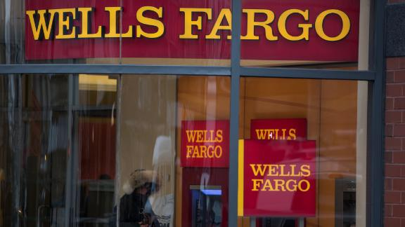 A customer uses an ATM (automated teller machine) at a Wells Fargo & Co. bank branch in New York, U.S., on Monday, Dec. 8, 2014. U.S. stocks dropped, following the worst loss in six weeks for the Standard & Poor's 500 Index, as global shares slid on concern over growth in China and potential political turmoil in Greece. Photographer: Ron Antonelli/Bloomberg via Getty Images