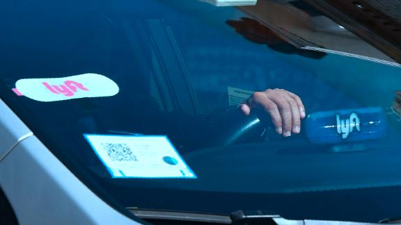A driver with the Lyft decal on his vehicle cruises Hollywood, California on February 21, 2019.