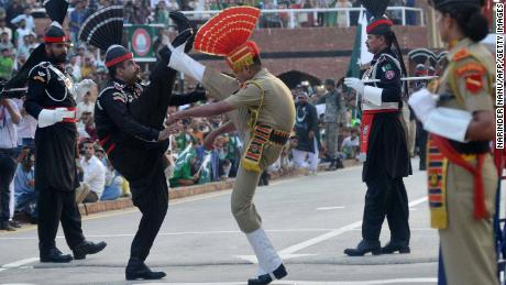 Pakistani rangers (L) and Indian security forces (R) perform the daily Beating Retreat ceremony at Wagah in August 2017.