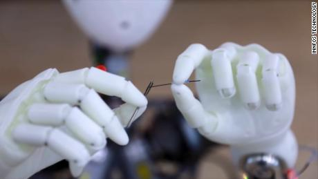 Watch this robot thread a needle