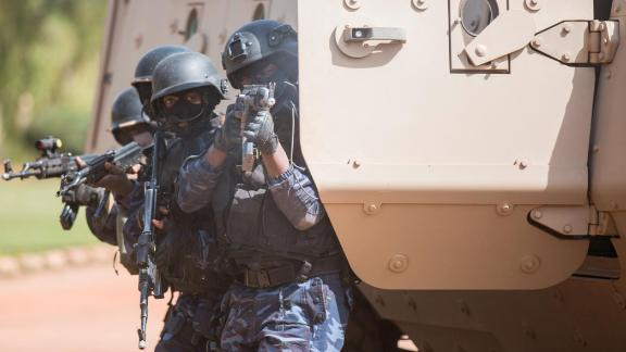 A Burkinabe police officer with the Special Intervention Unit (SIU) fires his AK-47 rifle during a simulated terrorist attack as part of exercise Flintlock 2019 in Ouagadougou, Burkina Faso, Feb. 27, 2019. Members of the SIU were the first responders to the simulated terrorist attack and responsible for neutralizing any threats. (U.S. Army photo by Staff Sgt. Anthony Alcantar)