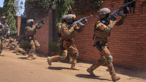 Malian soldiers, assigned to Battalion Autonomes des Forces Speciales tacticaly conduct close combat battle drills in Ouagadougou, Burkina Faso on Feb. 26, 2019. The close quarters battle training events like these are part of the Flintlock 2019 exercise scenarios. (U.S Army photo by Spc. Peter Seidler)