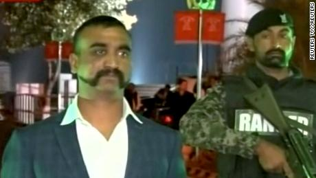 Indian pilot, Wing Commander Abhinandan, stands under armed escort near Pakistan-India border in Wagah, Pakistan in this March 1, 2019 image from a video footage.