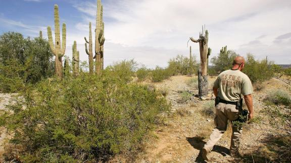 United States Fish and Wildlife Service officer Jeremy Bucher patrols the Cabeza Prieta National Wildlife Reserve near Ajo, Arizona.