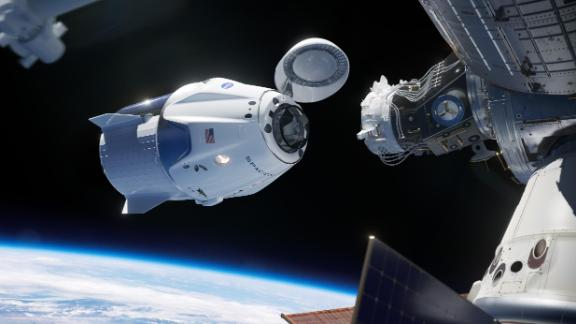 This artist illustration shows the SpaceX Crew Dragon spacecraft docking to the International Space Station. SpaceX is one of two American companies working with NASA to design, build, test and operate safe, reliable and cost-effective human transportation systems, restoring the nation