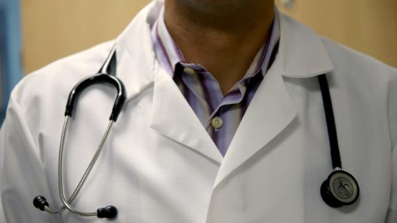 MIAMI, FL - JUNE 02:  A doctor wears a stethoscope as he see a patient for a measles vaccination during a visit to the Miami Children