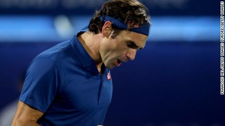 A pumped up Roger Federer reacts after winning the first set of the Dubai Open final against Stefanos Tsitsipas of Greece.