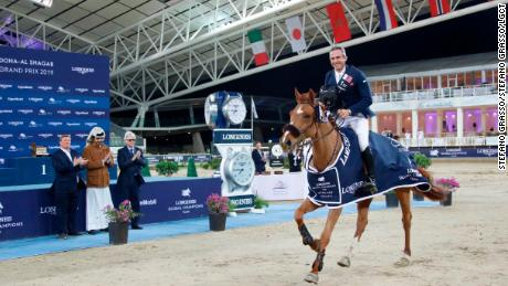 Julien Epaillard and  Usual Suspect d'Auge during their lap of honor in Doha.
