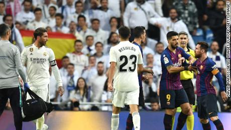 Lionel Messi reacts angrily to a challenge by Sergio Ramos as tempers flared in El Clasico.