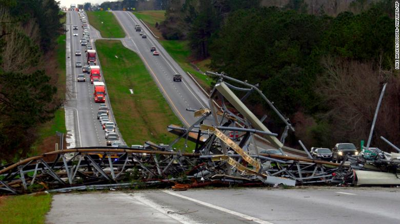 A fallen cell tower lies across U.S. Route 280 highway in Lee County, Alabama after what appeared to be a tornado struck in the area.