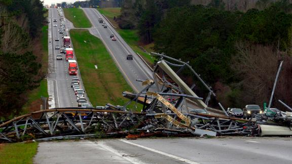 A fallen cell tower lies across U.S. Route 280 highway in Lee County, Alabama, after what appeared to be a tornado struck in the area.