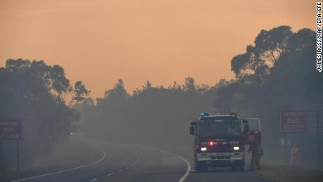 A Country Fire Authority (CFA) crew is seen on the Bunyip side of the Princes Highway on Sunday in the Australian state of Victoria.