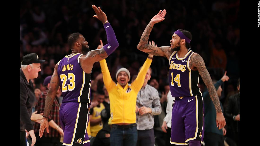 LeBron James of the Los Angeles Lakers, left, celebrates with teammate Brandon Ingram after making a three-pointer during the second half of an NBA game against the New Orleans Pelicans at Staples Center on Wednesday, February 27. The Lakers won the game 125-119.