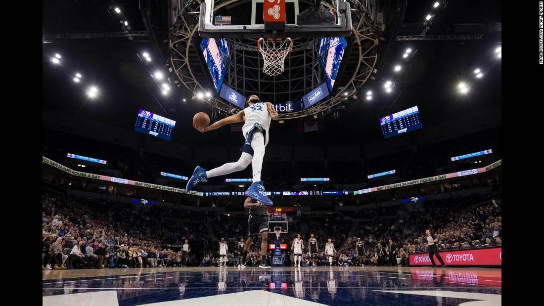 Minnesota Timberwolves center Karl-Anthony Towns dunks during the second quarter of an NBA game against the Sacramento Kings in Minneapolis, Minnesota, on Monday, February 25.