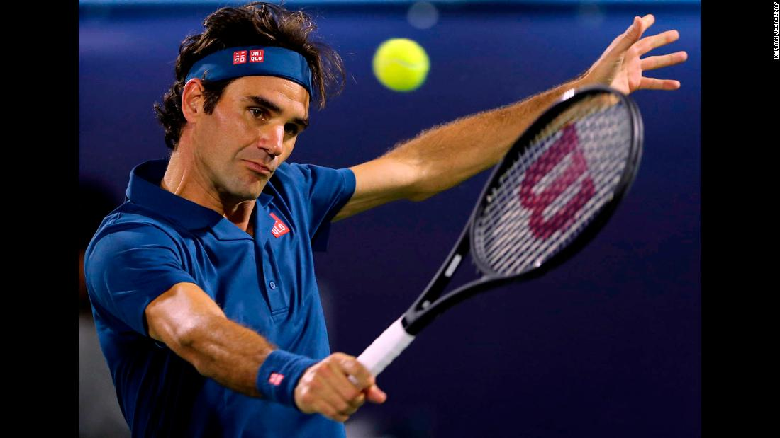 "Roger Federer returns a ball in his semifinal match with Borna Coric at the Dubai Duty Free Tennis Championship on Friday, March 1, in Dubai. On Saturday, Federer defeated Stefanos Tsitsipas in the finals to claim<a href=""https://www.cnn.com/2019/03/02/tennis/tennis-federer-100-titles-spt-intl/index.html"" target=""_blank""> his 100th career title.</a>"
