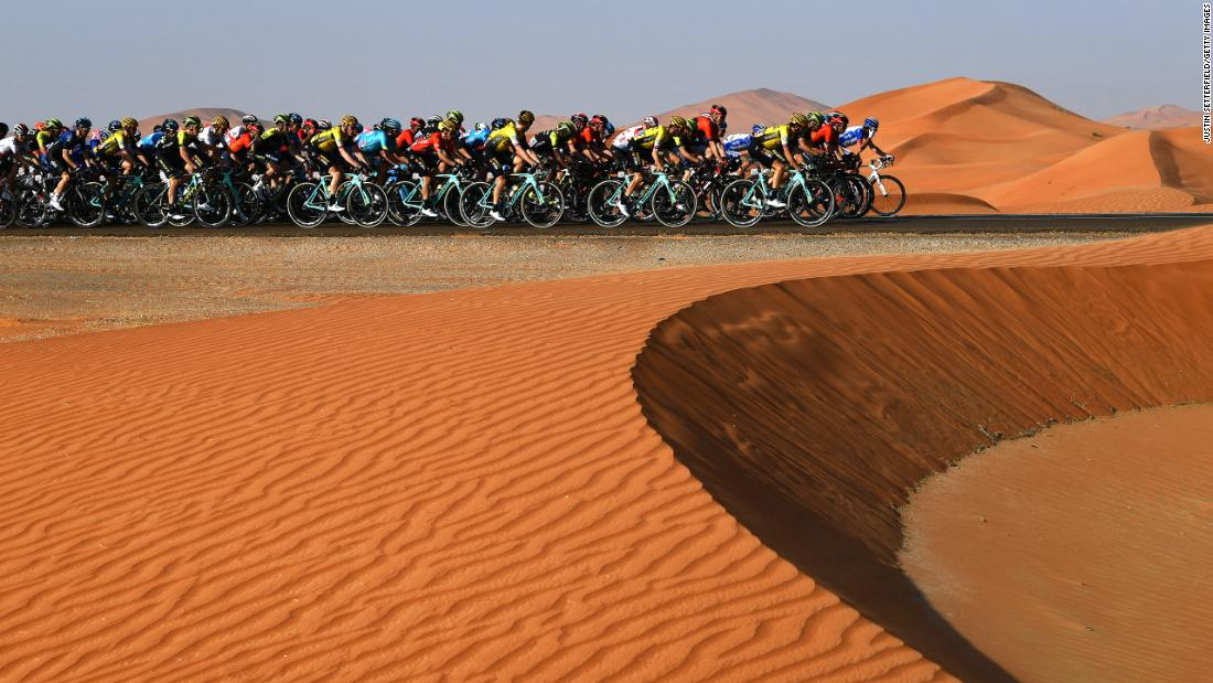 Cyclists ride through the desert during stage 3 of the UAE Tour in Jebel Hafeet, United Arab Emirates, on February 26.