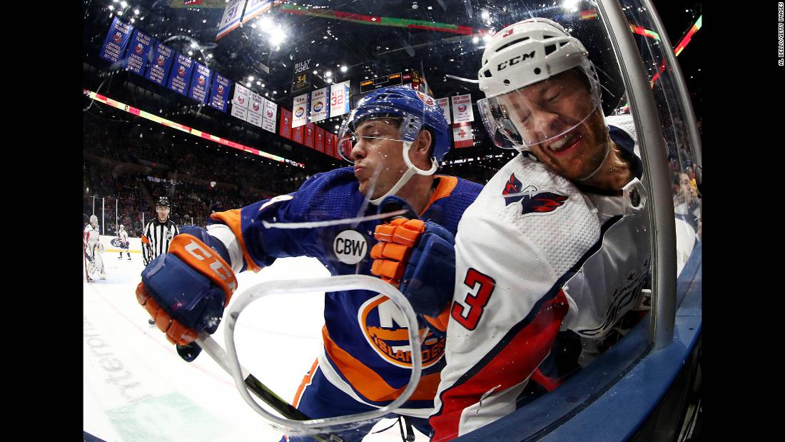 Tom Kuhnhackl of the New York Islanders, left, checks Nick Jensen of the Washington Capitals during their game on March 1, in Uniondale, New York.