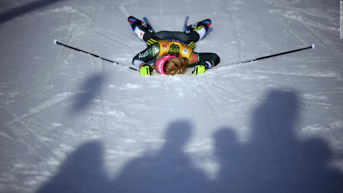 Laura Gimmler of Germany lies on the ground after crossing the finish line of the Cross-Country Women's 10k race of the FIS Nordic World Ski Championships on February 26, in Seefeld, Austria.