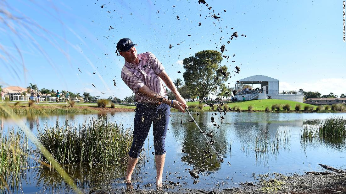 Trey Mullinax plays his ball from the mud off the 9th fairway during the first round of The Honda Classic at PGA National in Palm Beach Gardens, Florida, on Thursday, February 28.