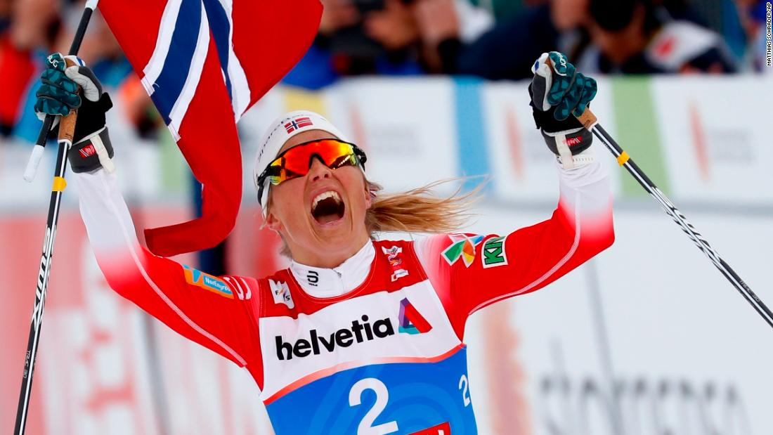 Norway's Therese Johaug celebrates winning the women's 30K Mass Start cross-country event at the Nordic Ski World Championships in Seefeld, Austria on Saturday, March 2.