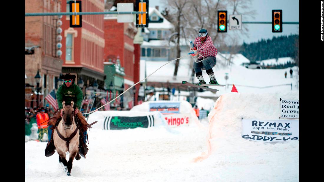 Alan Mikkelson races on horseback down Harrison Avenue in Leadville, Colorado, while skier Jason Dahl airs off a jump at the 71st annual Leadville Ski Joring competition on March 2. Skijoring, which has its origins as a competitive sport in Scandinavia, has been adapted over the years to include jumps and slalom gates. Leadville has been hosting skijoring competitions since 1949.