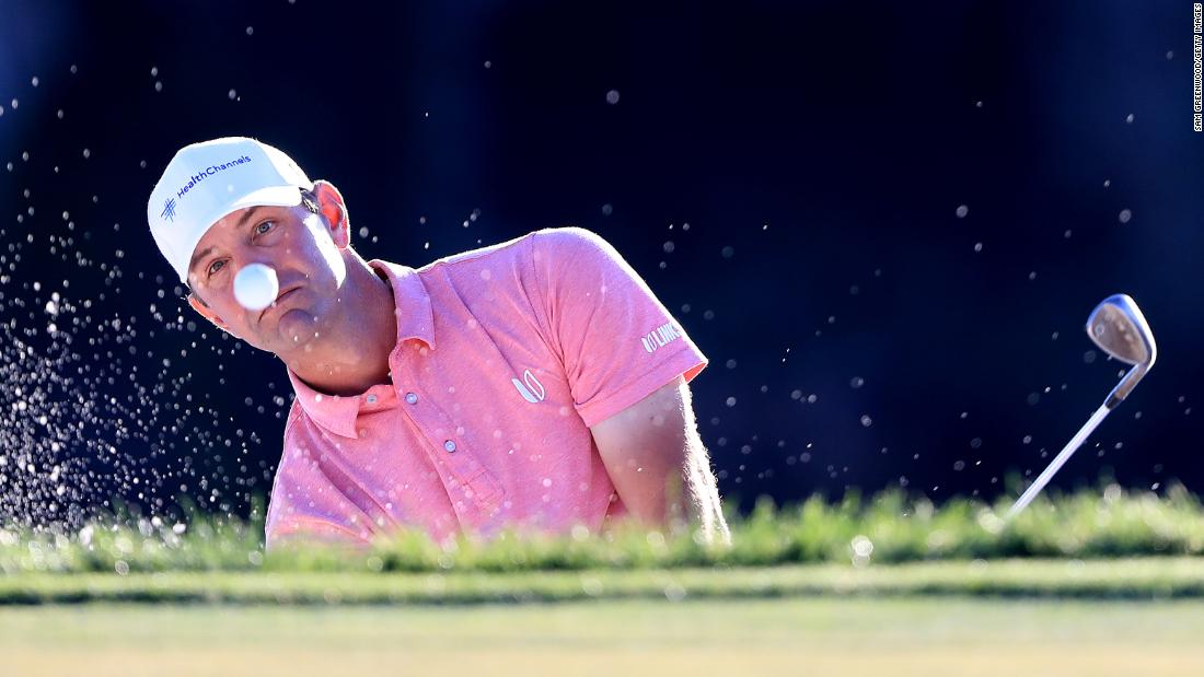 Lucas Glover plays a shot from a bunker during the first round of the Honda Classic at PGA National on February 28.