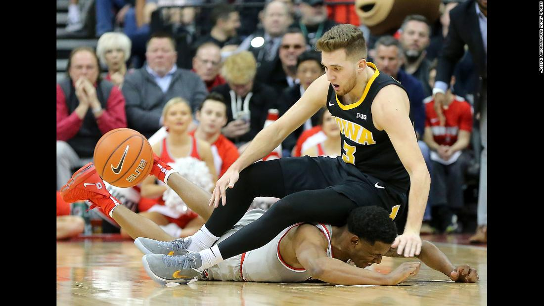 "Ohio State Buckeyes guard C.J. Jackson battles for the ball with Iowa Hawkeyes guard Jordan Bohannon during the first half of an NCAA basketball game at Value City Arena on February 26. <a href=""https://www.cnn.com/2019/02/24/sport/gallery/what-a-shot-sports-0224/index.html"" target=""_blank"">See 25 amazing sports photos from last week</a>"
