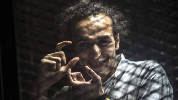 Mahmoud Abou Zeid gestures from inside a soundproof glass dock during his trial in August 2016.