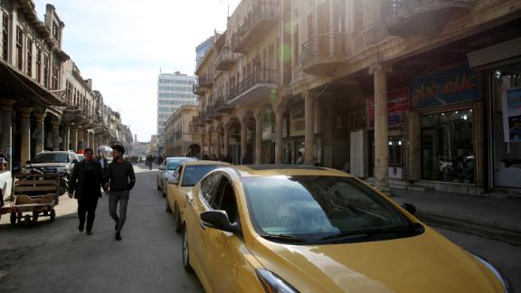 A general view shows traffic on Al-Rashid Street in Baghdad