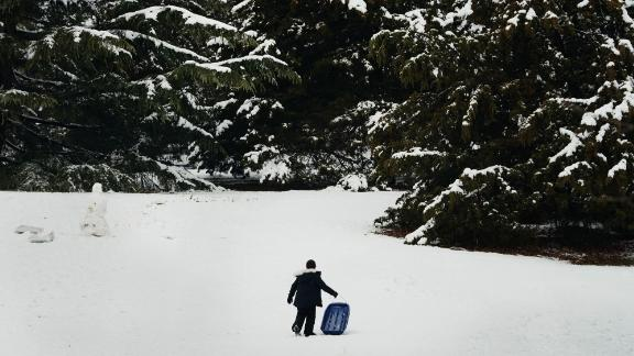 A boy sleds in Manhattan's Central Park on Monday after a late-season snowstorm.