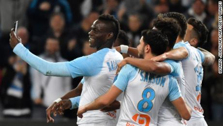 Balotelli takes a selfie with teammates after scoring during a Ligue 1 match