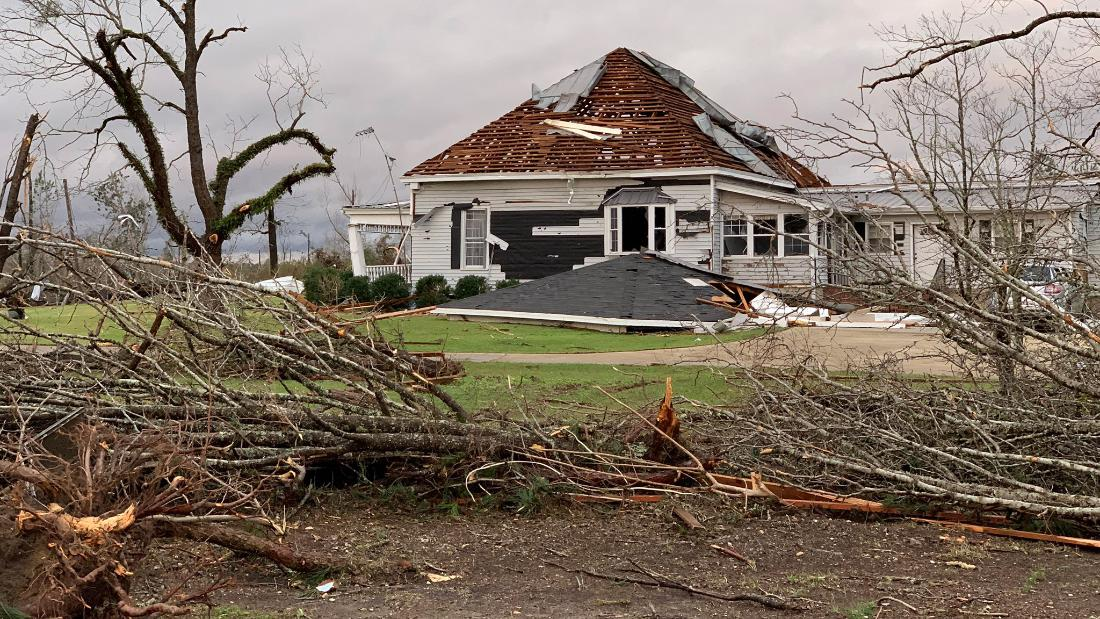A home's roof is damaged after a tornado hit Beauregard, Alabama, on Sunday, March 3.