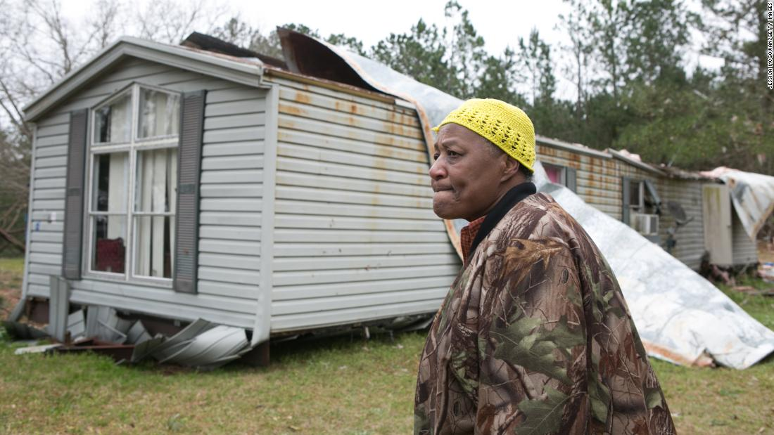 Christine Richardson stands in front of her damaged house in Beauregard on Monday, March 4.