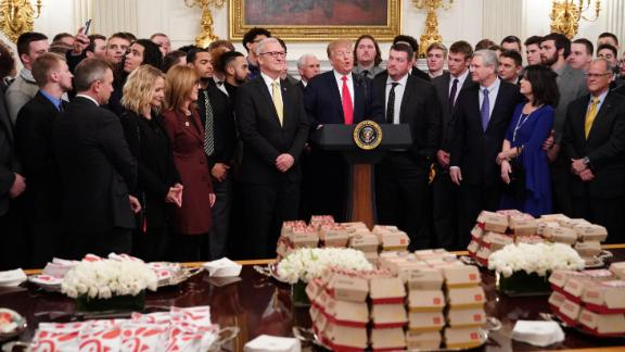 US President Donald J. Trump welcomes the 2018 FCS Division I Football National Champions, the North Dakota State Bison team to the White House on March 4, 2019 in Washington,DC. - A spread of french fries, chic-fil-a sandwiches and Big Macs awaited the North Dakota State University Bison football team. (MANDEL NGAN/AFP/Getty Images)