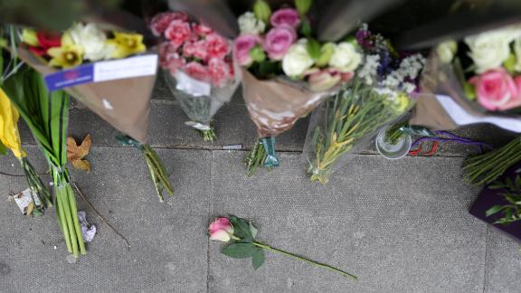 Floral tributes are pictured in London
