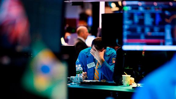 A trader works at his desk on the floor of the New York Stock Exchange (NYSE) after the opening Bell on March 4, 2019 in New York City.