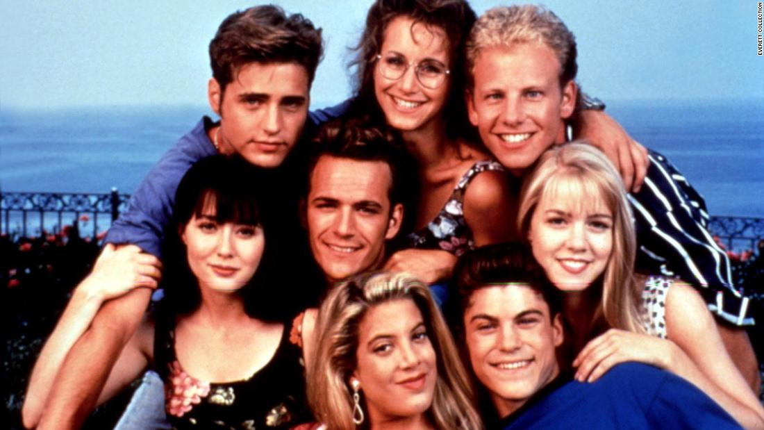 "Perry, center, became a star while playing Dylan McKay on the hit TV series ""Beverly Hills, 90210."" Posing with Perry here, clockwise from top left, are Jason Priestley, Gabrielle Carteris, Ian Ziering, Jennie Garth, Brian Austin Green, Tori Spelling and Shannen Doherty."