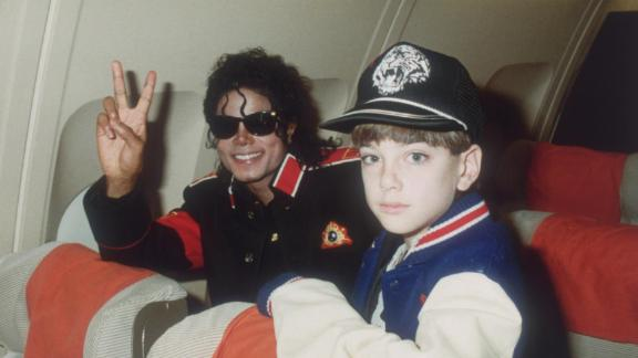 Michael Jackson pictured with James Safechuck, then aged 10, on a tour plane in 1988.