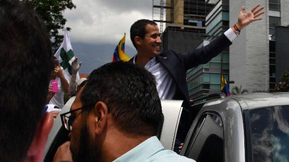 Venezuelan opposition leader and self-proclaimed acting president Juan Guaido greets supporters upon his arrival in Caracas on March 4, 2019. - Venezuela
