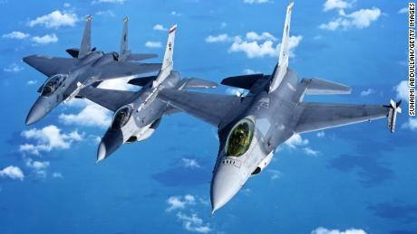 Two Singaporean F-16s fly in formation with an F-16 15 years 2017. The country's defense minister says the F-16 century will be outdated in 2030.