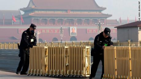 Chinese police officers push away barriers before delegates arrive for a meeting on the eve of the opening session of the National People's Congress, at the Great Hall of the People in Beijing, China, Monday, March 4, 2019.