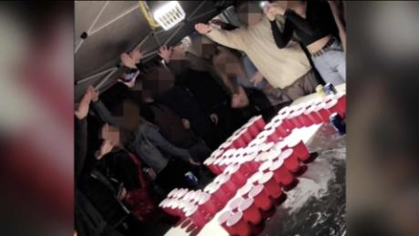 A screenshot of a video showing students holding the Nazi greeting at a party in Newport Beach, California.
