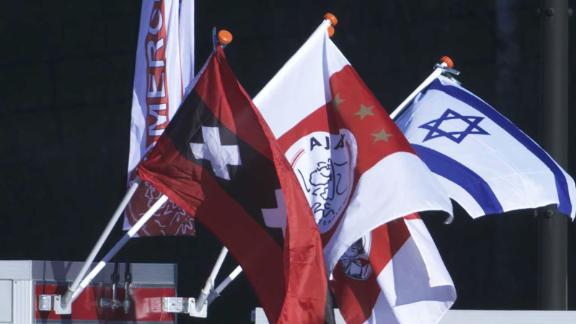 Stalls close to the Johan Cruyff Arena sell Israeli flags to supporters.